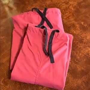 Two burgundy uniform scrub pants